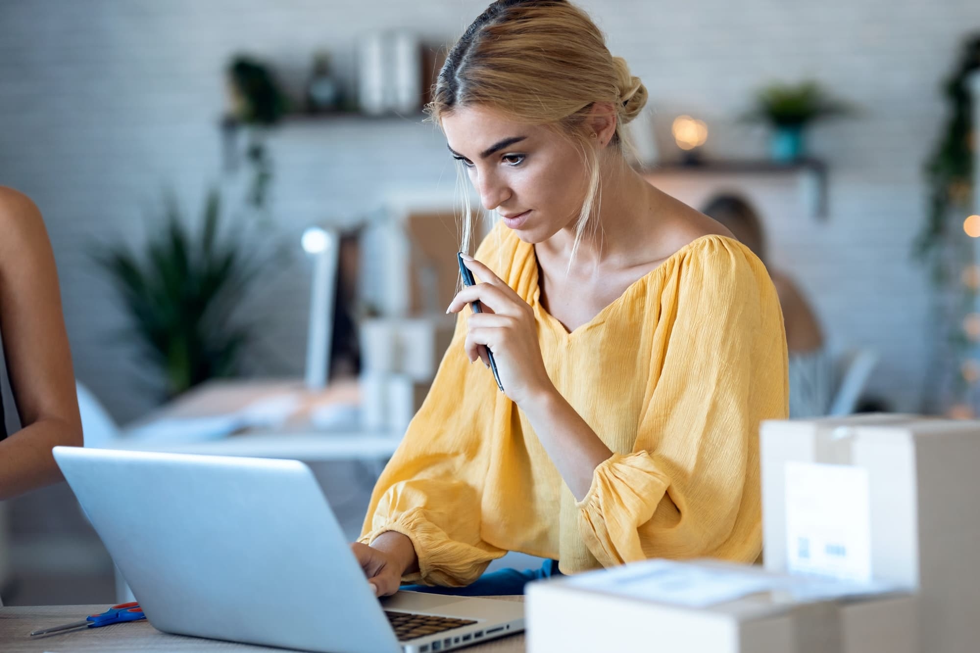 freelance business woman seller checking product order with computer